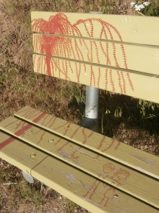 Red willow tree painted on green bench