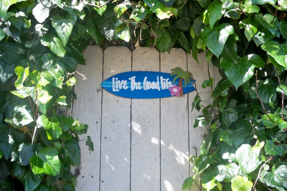 """Live the Good Life"" sign on a gate"