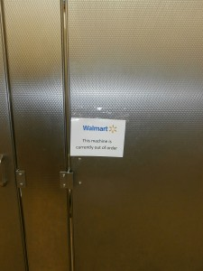 A restroom stall with an out-of-order sign