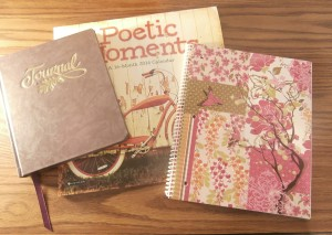 Photo of a calendar, a notebook, and a journal
