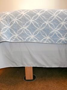 Bed risers under a queen bedframe