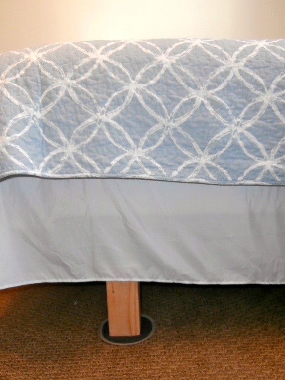 Bed risers under a queen bedframe