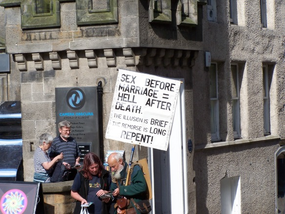 Edinburgh street preacher holding a sign