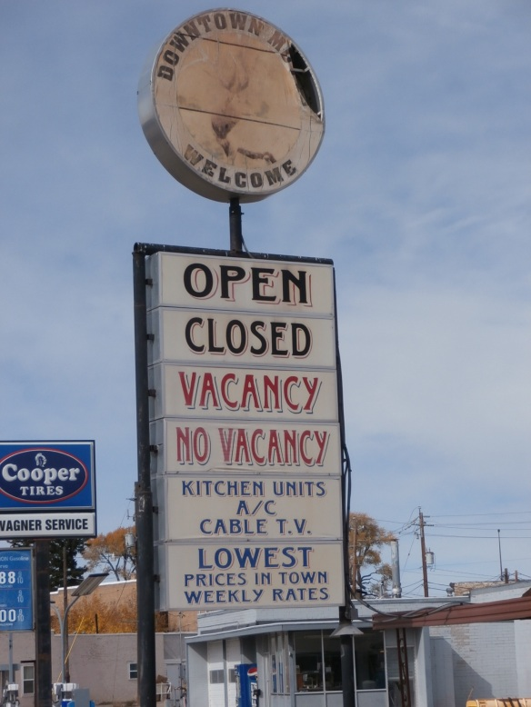 "Sign for a motel that reads, ""Open, Closed, Vacancy, No Vacancy."""