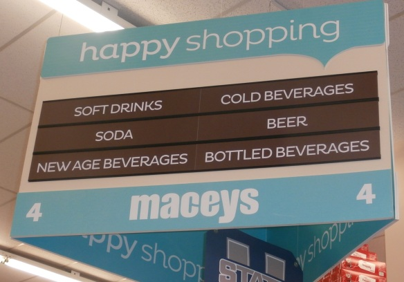 "Grocery store sign declaring that the ""new age beverages"" are on aisle 4"