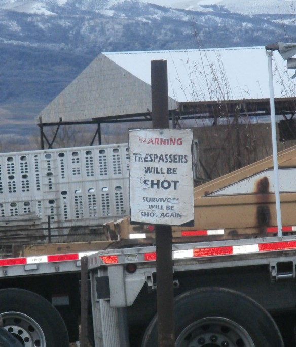 A sign stating that trespassers will be shot