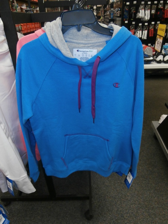 A photo of a hoodie hanging on a store rack