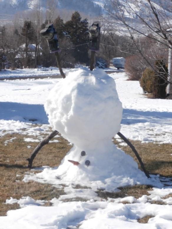 An snowman standing on its head