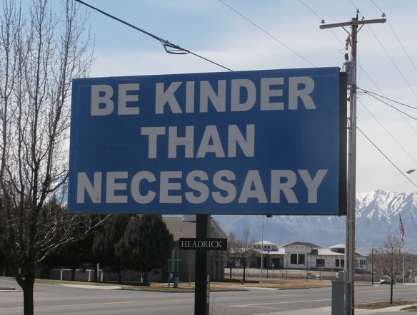 "Billboard stating ""Be Kinder Than Necessary"""