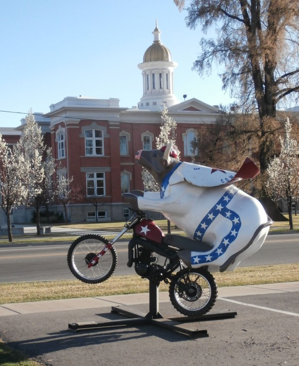 Statue of a bull on a motorcycle