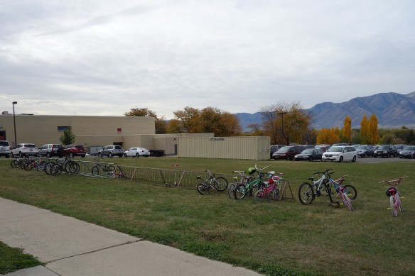 A long bike rack at an elementary school