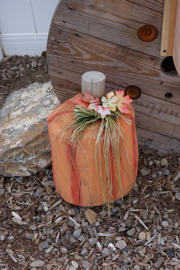 A wooden pumpkin decoration