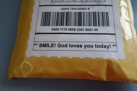 A mailing label with a decorative edge and an uplifting message