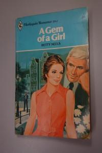 A vintage paperback romance novel titled A Gem of a Girl