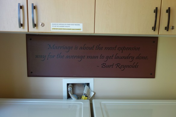A humorous sign hanging in a laundry room