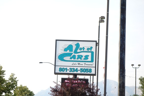 Sign for a used car dealer business: A Lot of Cars