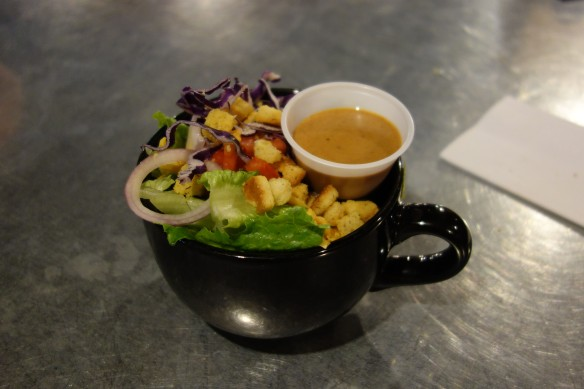 A salad served in a soup bowl