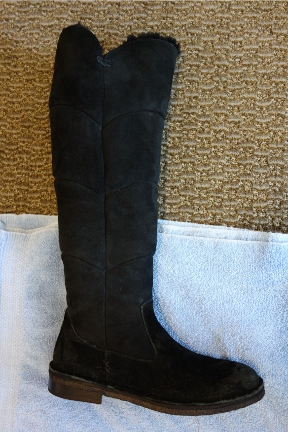 A black boot with a black sole