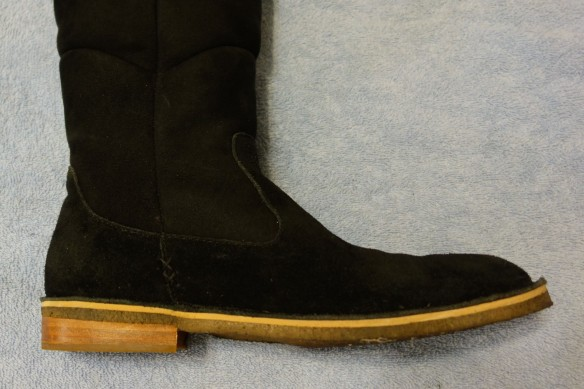 A black boot with a brown sole