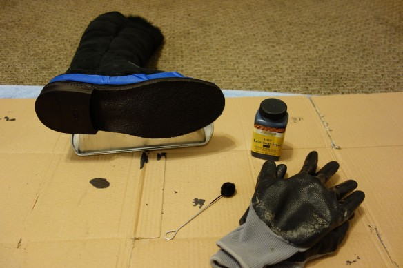 Brown boot sole in the process of being dyed black