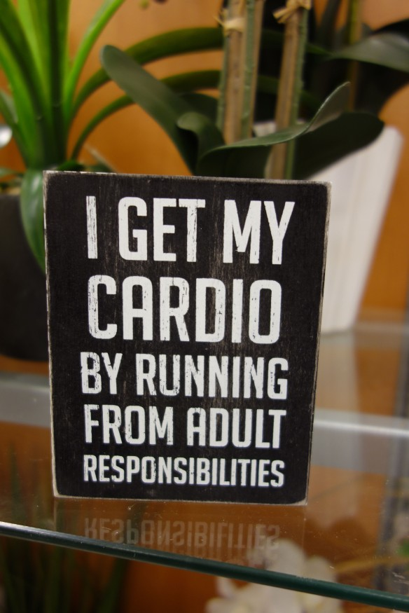 "Sign reading: ""I get my cardio by running from adult responsibilities."""""
