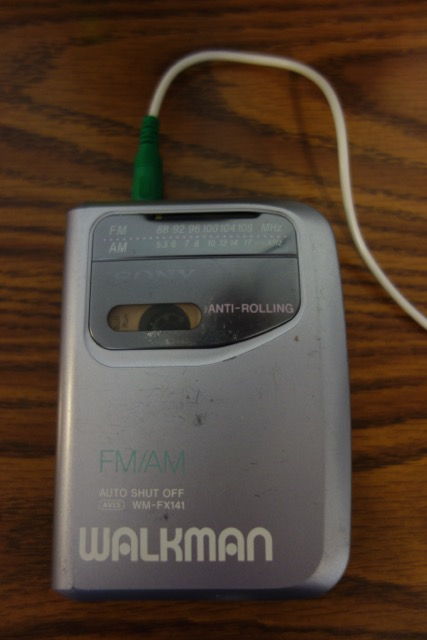 A Walkman portable radio/cassette tape player