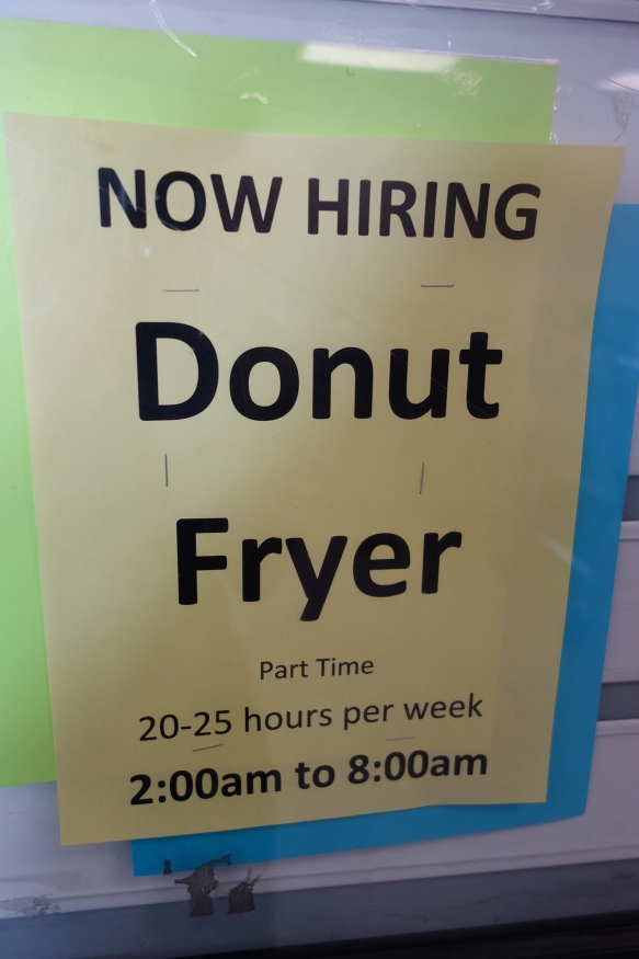 A Help Wanted sign seeking a donut fryer to work from 2am to 8am.