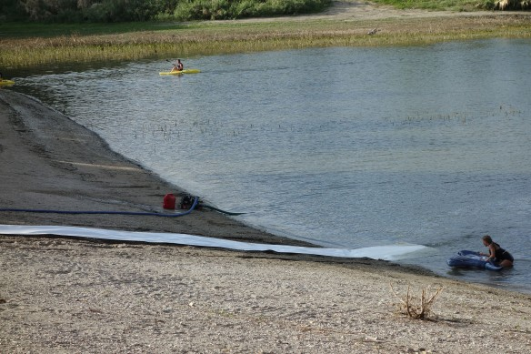 A large DIY tube slide set up at a public reservoir