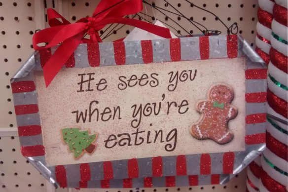 "A decorative Christmas sign that says, ""He Sees You When You're Eating"""