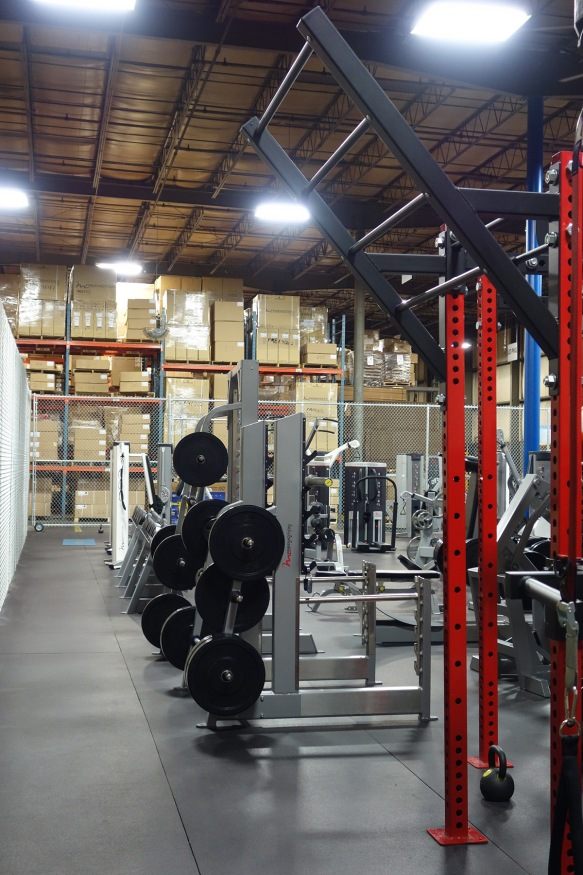 An employee gym located inside a warehouse