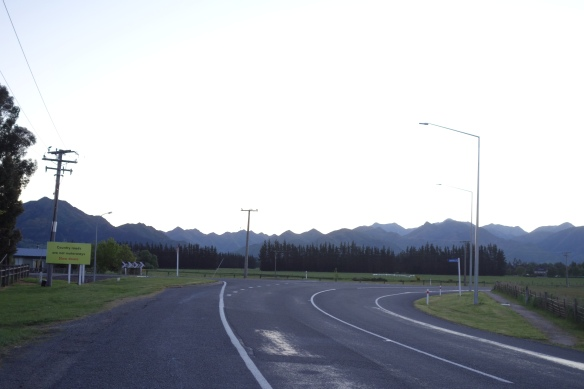 Sign advising motorists to slow down on country roads