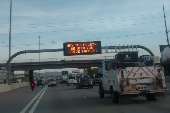 "A state transportation sign on the interstate reading: ""May the Fourth Be With You, Drive Safely"""