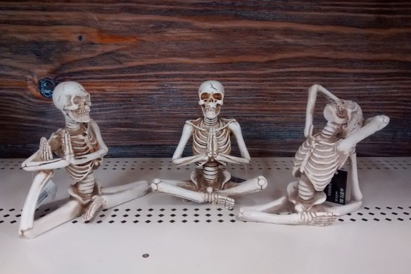 Statues of skeletons in yoga poses