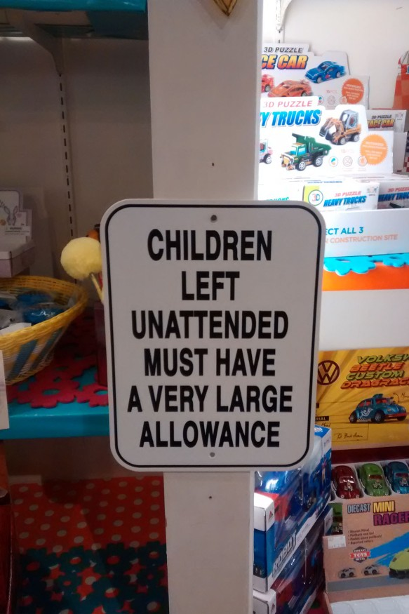"Sign in a decor store stating ""Children left unattended must have a very large allowance"""
