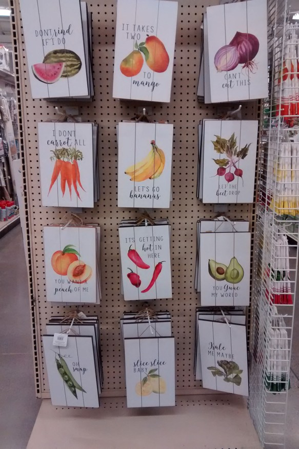 Decorative signs featuring fruits and vegetables with clever sayings