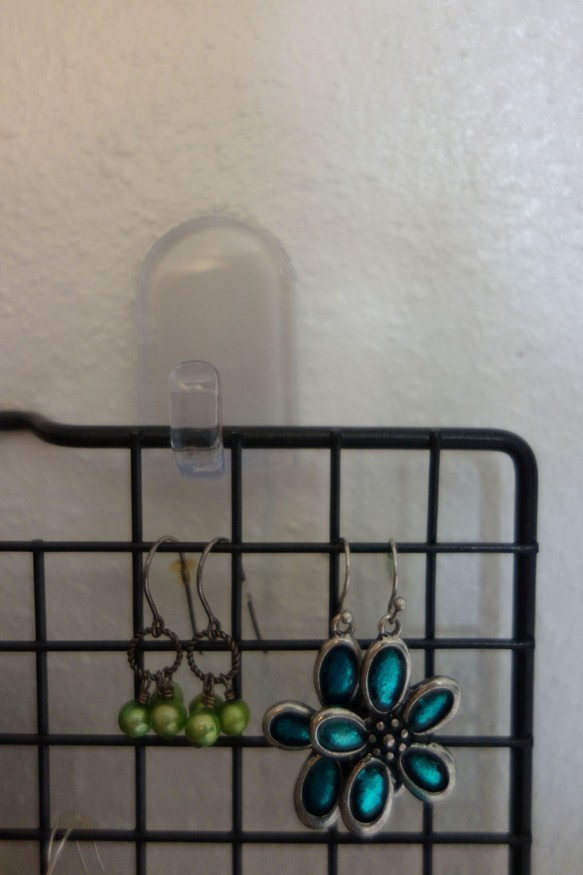An earring rack made from a cooling rack and two adhesive hooks